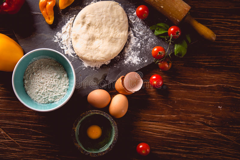 Download Fresh And Tasty Homemade Pizza On Wooden Table With Ingredients Stock Photo - Image: 83724163