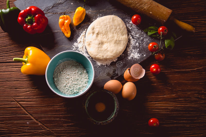 Download Fresh And Tasty Homemade Pizza On Wooden Table With Ingredients Stock Image - Image: 83724187