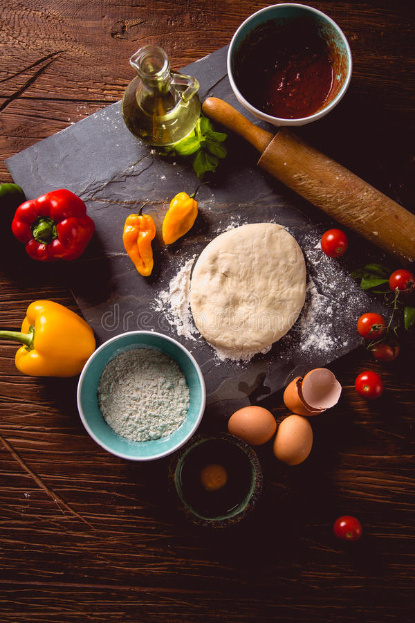Download Fresh And Tasty Homemade Pizza On Wooden Table With Ingredients Stock Photo - Image: 83724209