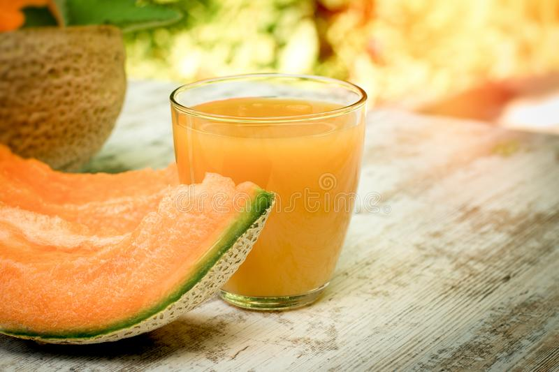 Fresh, tasty and juicy melon - cantaloupe and melon juice smoothie on table stock images