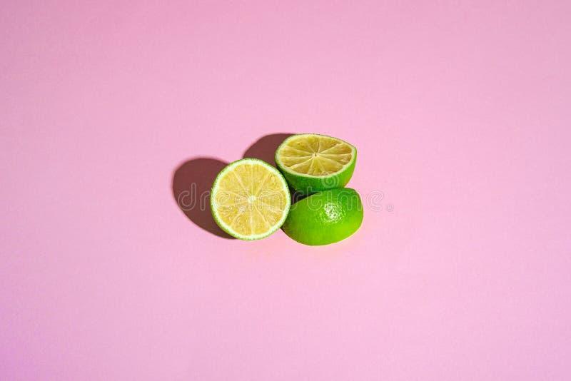 Fresh tasty lime citrus fruits half slices royalty free stock photo