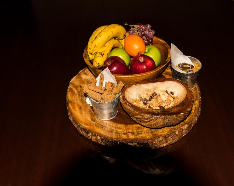 Fresh and tasty organic fruit compilation on wooden table. A `welcome` fruit basket for use in the hospitality industry royalty free stock photo