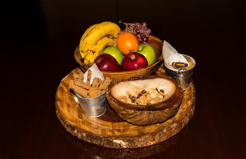Fresh and tasty organic fruit compilation on wooden table. A `welcome` fruit basket for use in the hospitality industry royalty free stock image