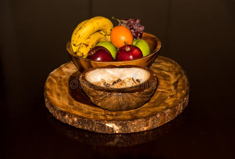 Fresh and tasty organic fruit compilation on wooden table. A `welcome` fruit basket for use in the hospitality industry royalty free stock photography