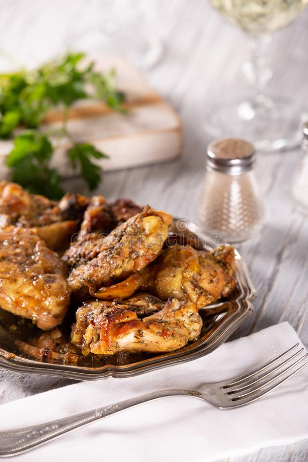 Fresh tasty part of fried chicken with spices stock photo