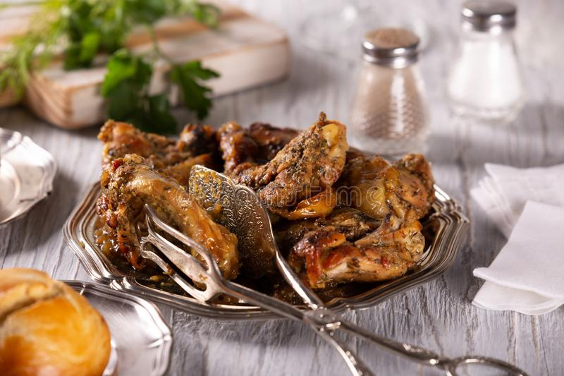 Fresh tasty part of fried chicken with spices royalty free stock photography