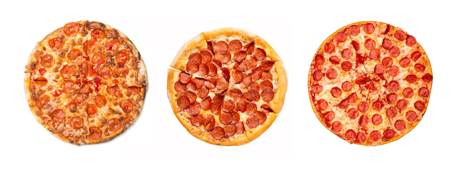 Fresh tasty pepperoni pizza group isolated on white background. Top view.  royalty free stock photos