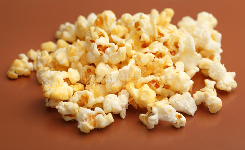 Fresh tasty popcorn. Pile of fresh tasty popcorn in closeup royalty free stock photo