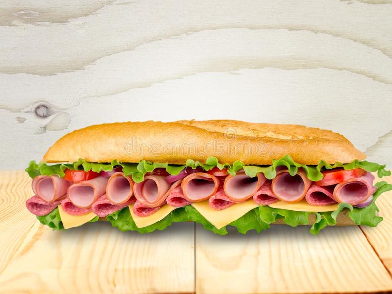 Fresh tasty sandwich with ham, close-up view royalty free stock photography