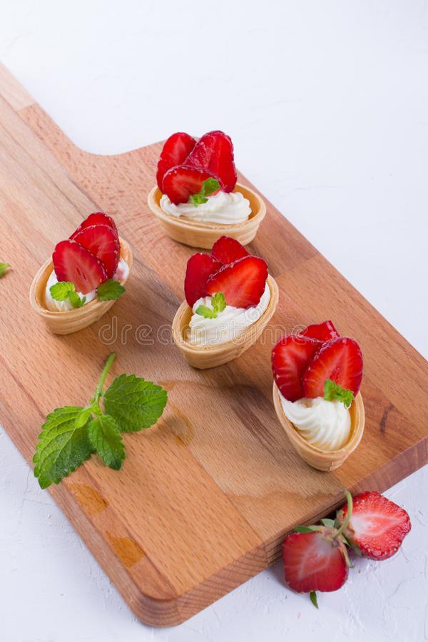 Fresh and tasty snack with cream cheese fruits and berries. royalty free stock image