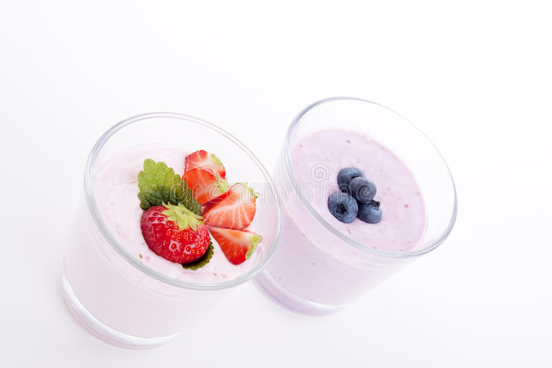Fresh tasty strawberry blueberry yoghurt shake cream stock photography