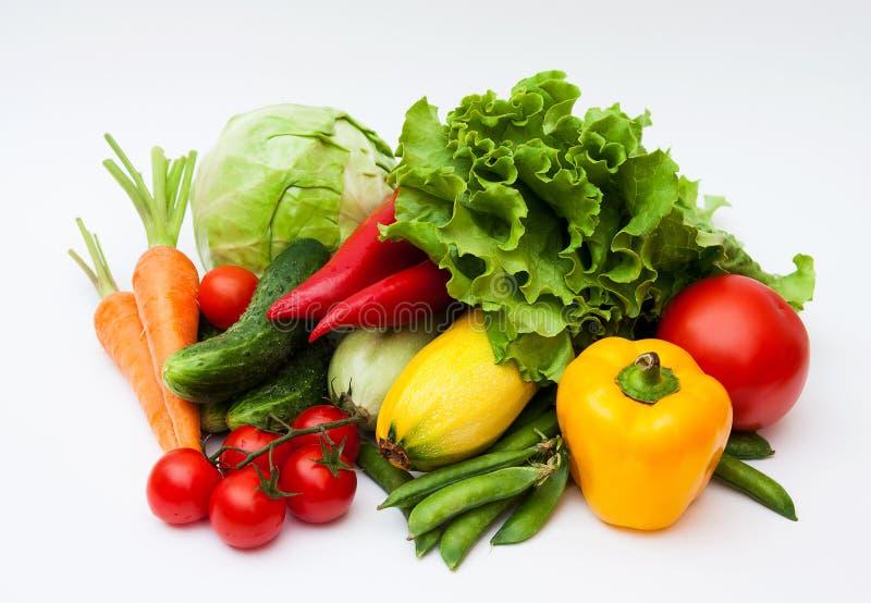 Fresh tasty vegetables on white. stock photography