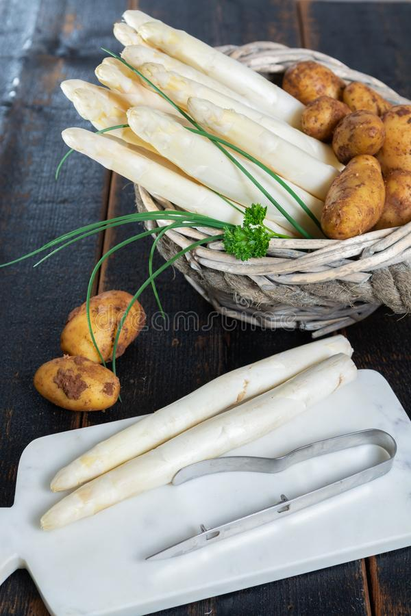 Fresh tasty white asparagus and potatoes, seasonal vegetable, new harvest, ready to cook royalty free stock photo