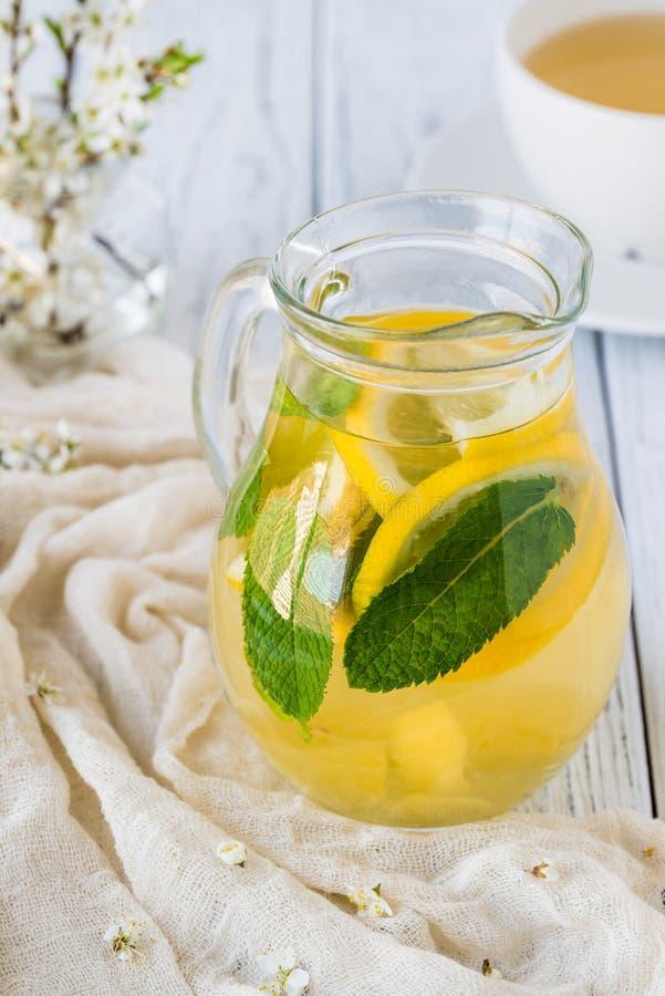 Fresh tea in glass jar with lemon, mint, ginger stock photos