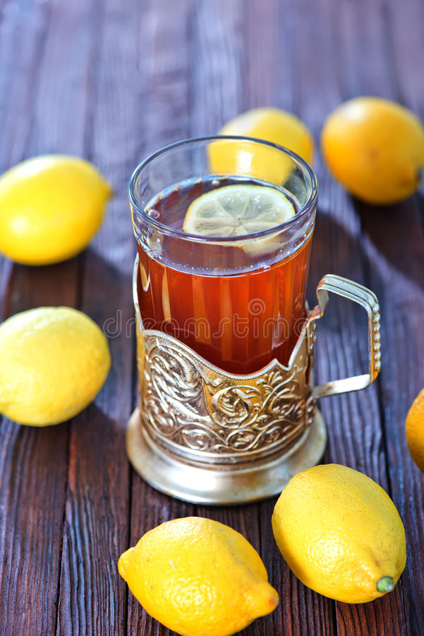 Fresh tea. With lemon in cup and on a table stock photo
