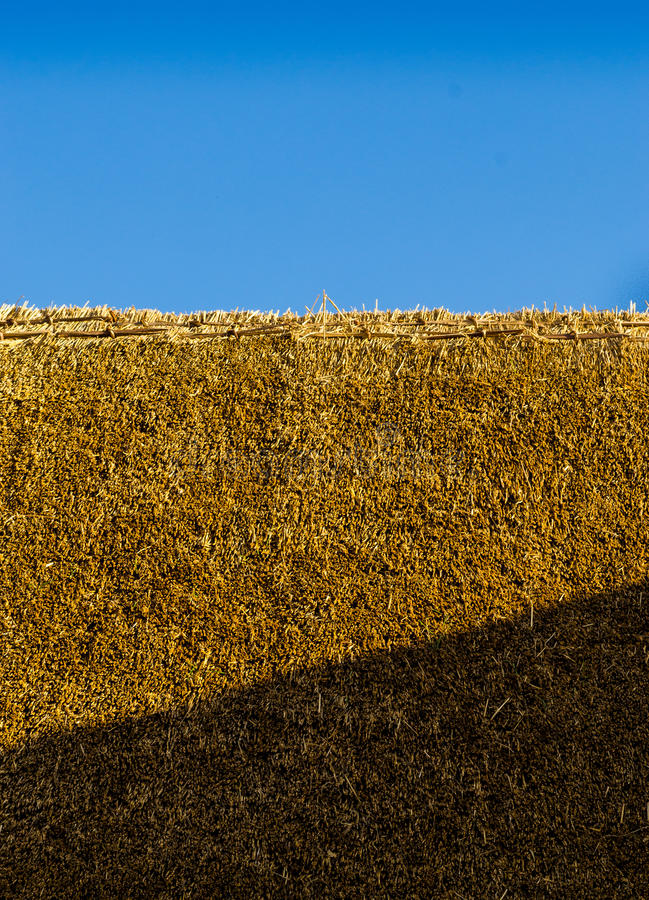 Fresh Thatch Roof. Closeup detail of a freshly thatched roof using professional thatch materials royalty free stock photos