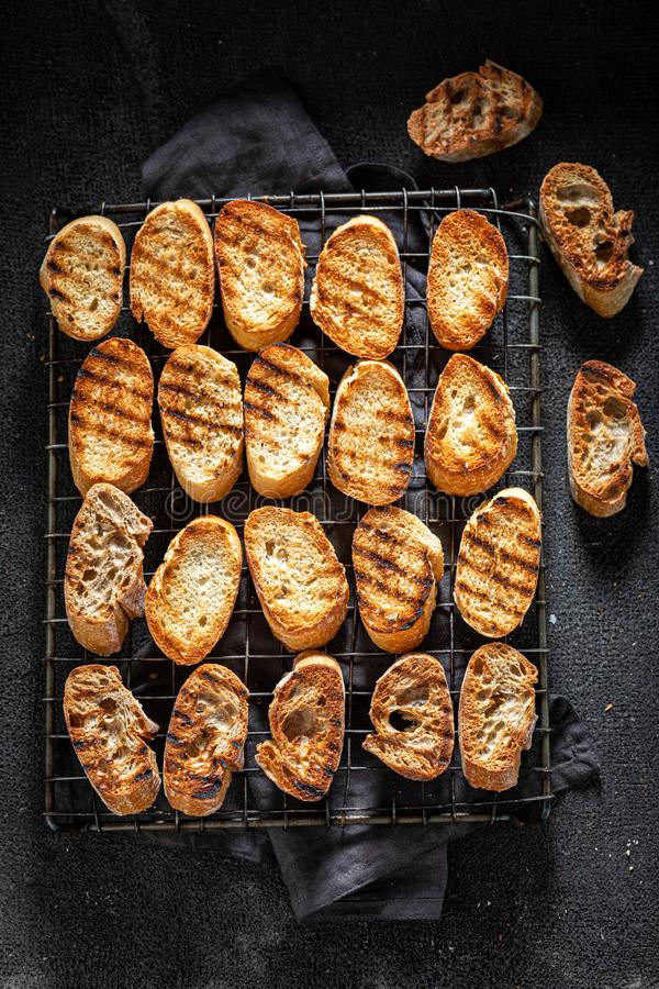 Fresh toasted wholegrain bread roasted on the grill grate stock image