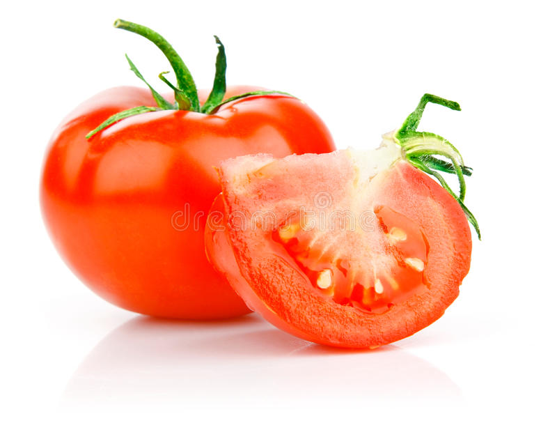 Fresh tomato with cut and leaves royalty free stock photography
