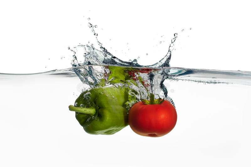 Fresh Tomato And Pepper Splash In Water Isolated On White Backgr Stock Photo