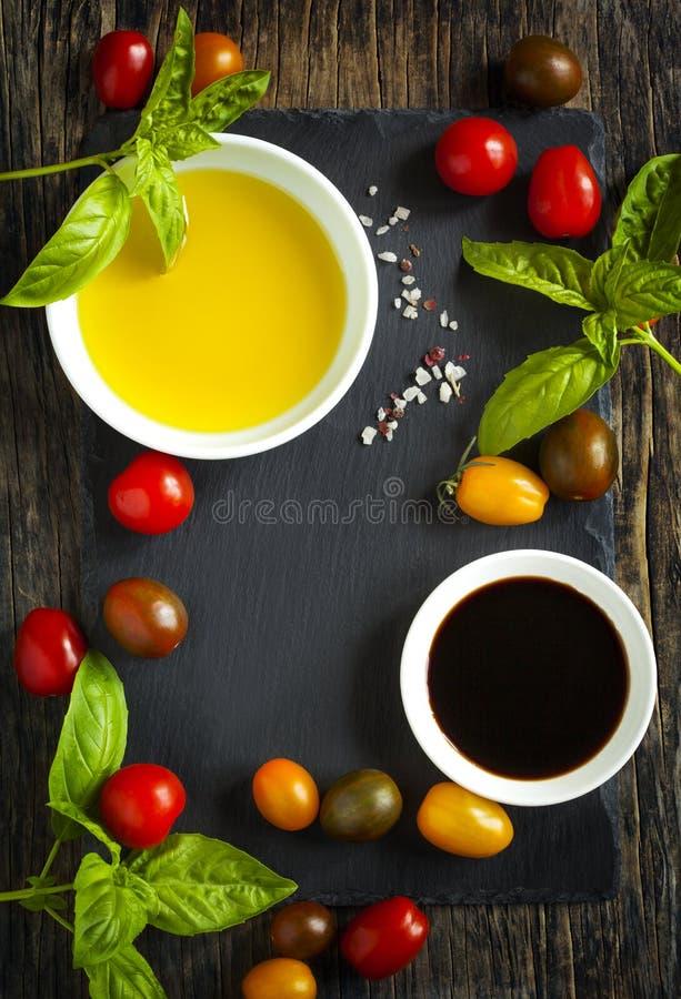 Fresh tomatoes, basil, olive oil and balsamic vinegar royalty free stock photo