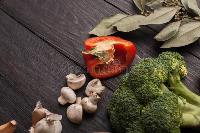 Fresh tomatoes and chilli closeup on grey rustic wood. Fresh organic vegetables on wood background. Bell pepper, garlic and broccoli on rustic kitchen table stock photo