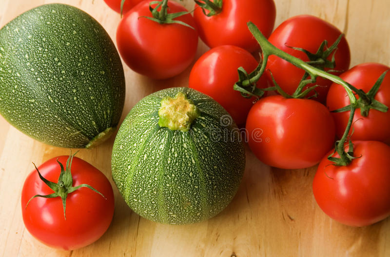 Fresh Tomatoes And Courgettes Stock Images