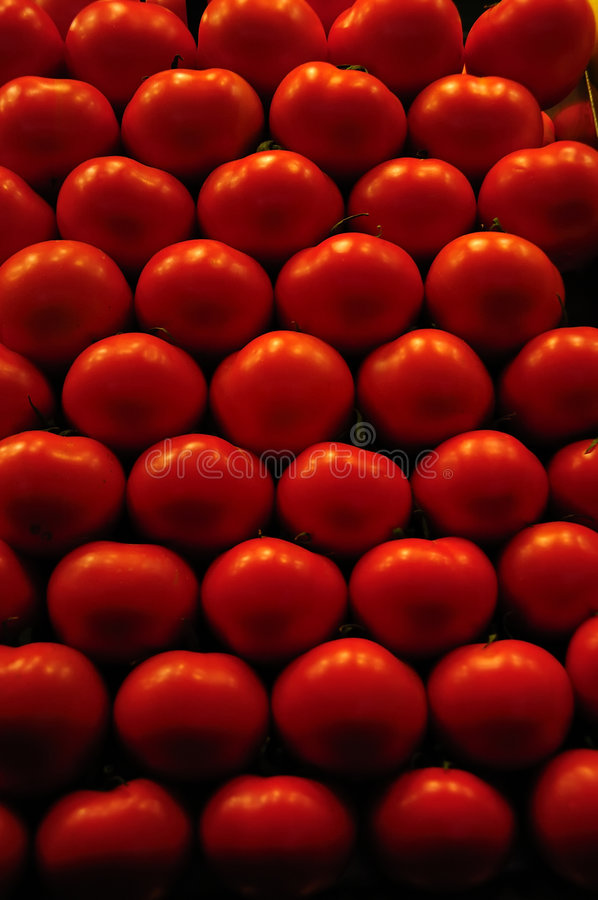 Fresh tomatoes on display at a market in Spain stock images