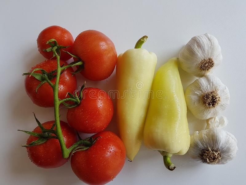 Fresh tomatoes and garlic organic natural vegetables healthy foods. Raw royalty free stock image