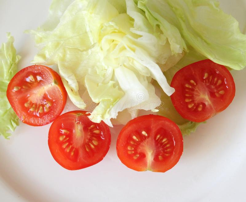Tomatoes and salad stock photography