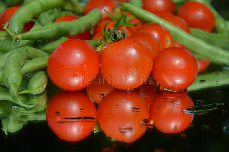 Fresh tomatoes and peas royalty free stock images