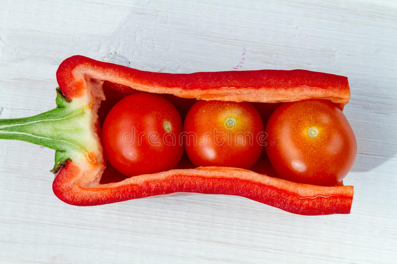 Fresh tomatoes, peppers arranged stock image