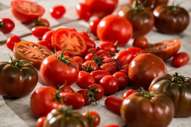 Fresh tomatoes. red tomatoes background. Group of tomatoes. Slice tomato royalty free stock image