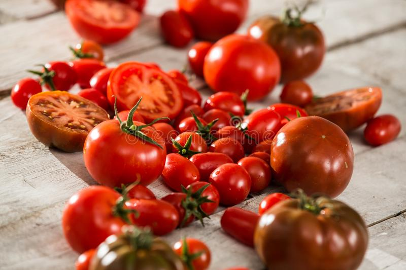 Fresh tomatoes. red tomatoes background. Group of tomatoes. Slice tomato royalty free stock photos
