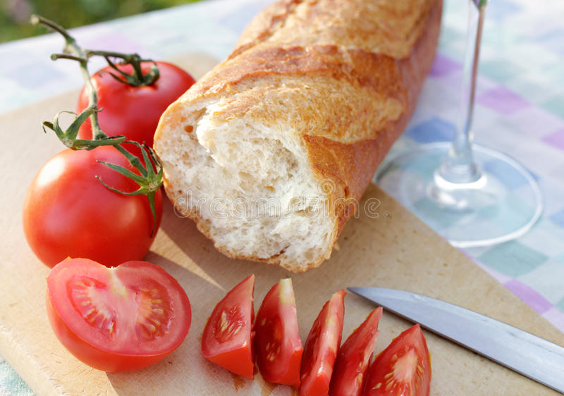 Fresh tomatoes with white bread stock photography