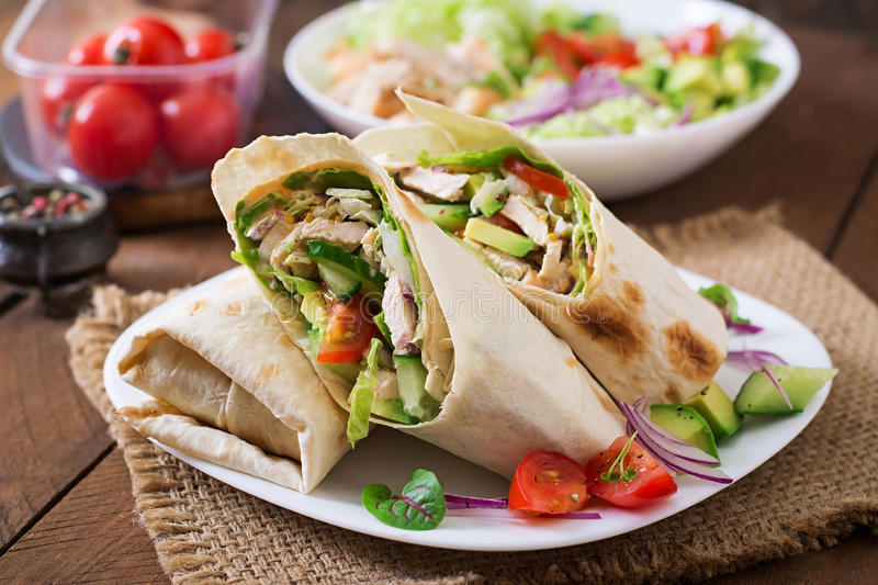 Fresh tortilla wraps with chicken and fresh vegetables royalty free stock photography