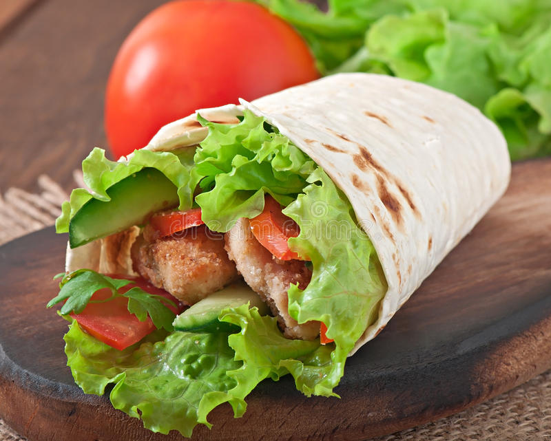 Fresh tortilla wraps with chicken nuggets stock photo