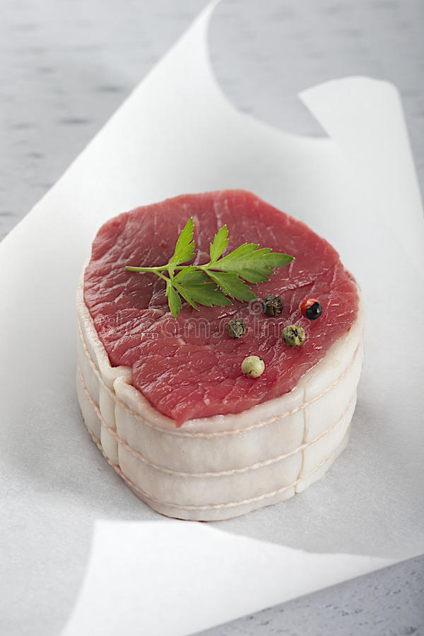 Fresh tournedos beef. 2 Juicy thick center cut tournedos beef,on white baking paper stock photo