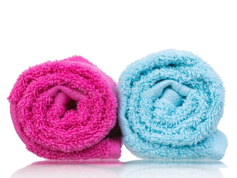 Fresh towel pair rolled-up closeup royalty free stock photos