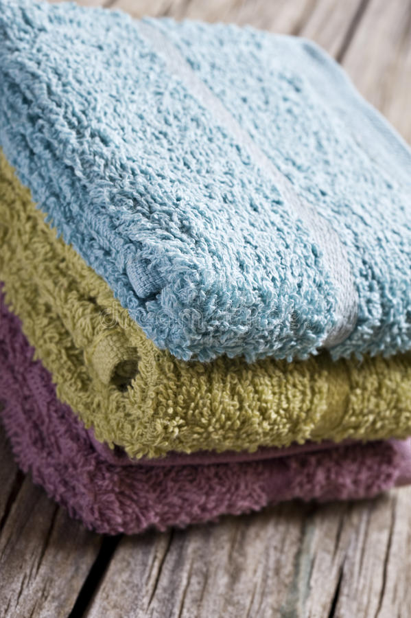 Fresh towels. On a rustic wooden surface royalty free stock photography