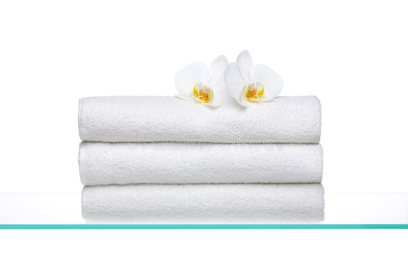 Fresh Towels with white Orchids stock photography