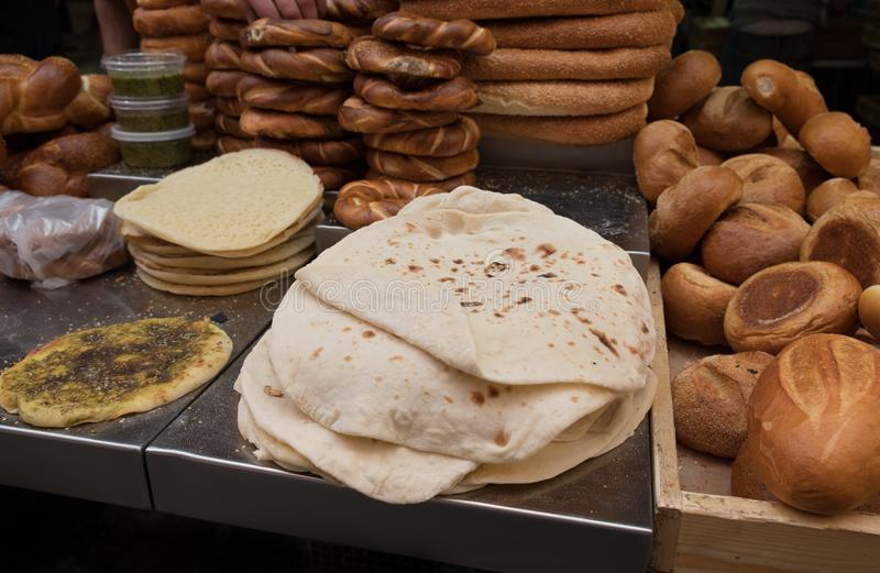 Fresh tradition iraqian bread and group of baked goods. For sale at Mahane Yehuda Market, popular marketplace in Jerusalem, Israel stock photos