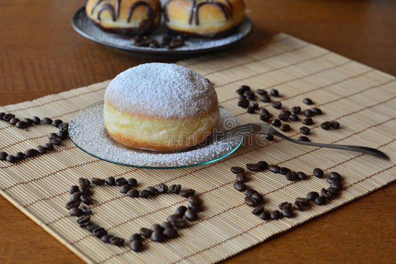 Fresh traditional doughnut with icing sugar royalty free stock photo