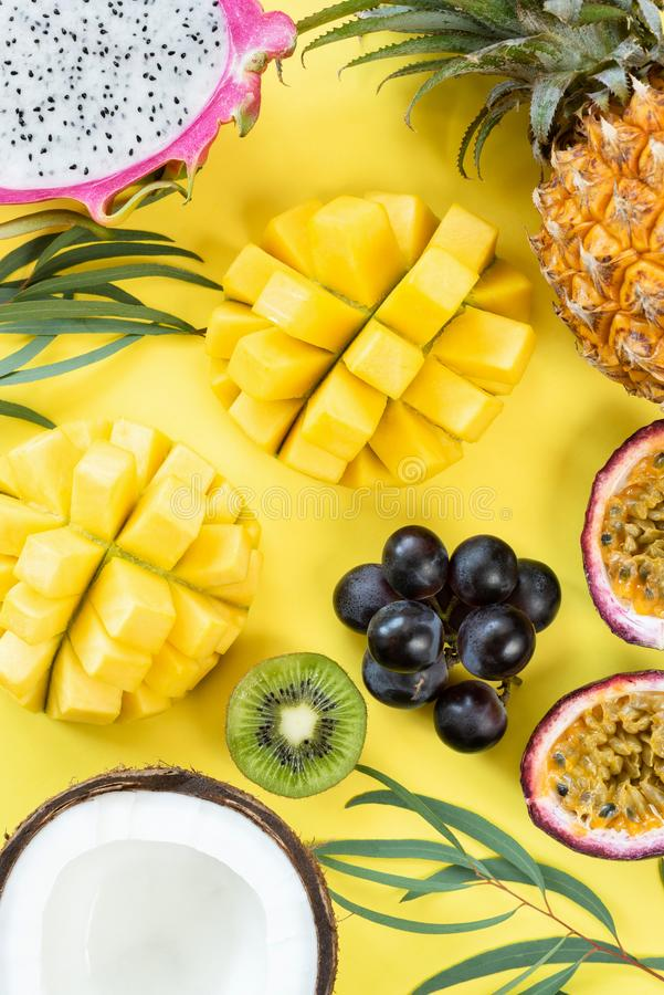 Fresh tropical fruits on yellow background stock photography