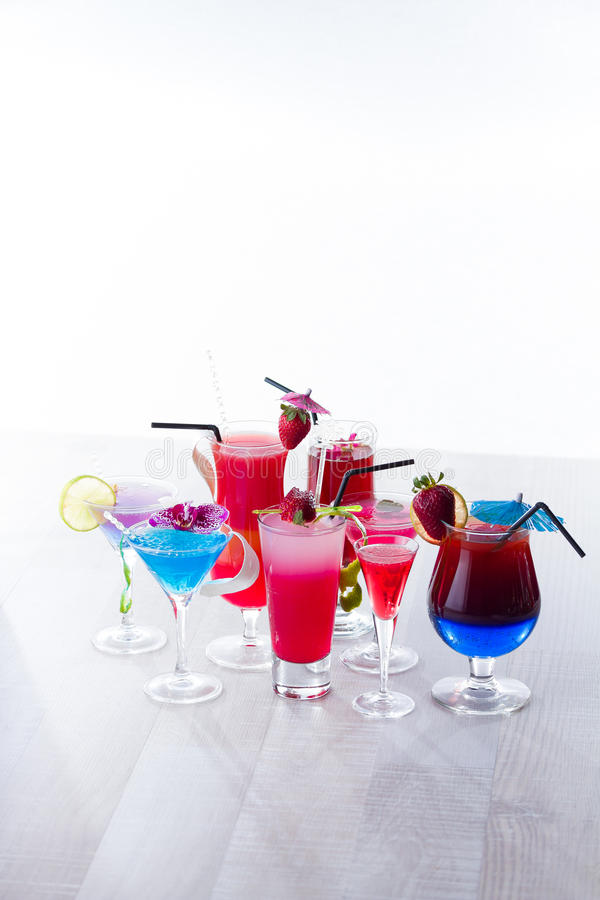 Fresh tropical layered cocktails over white. Background stock image