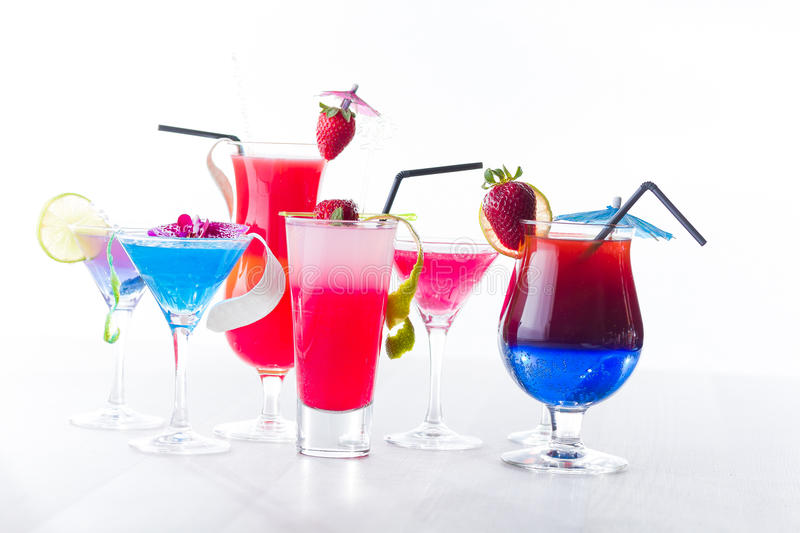 Fresh tropical layered cocktails. Over white background royalty free stock image