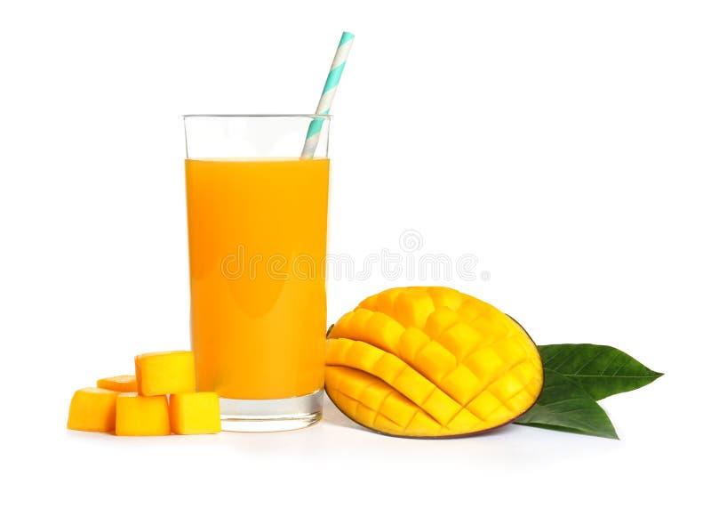 Fresh tropical mango juice and fruit. Isolated on white stock image