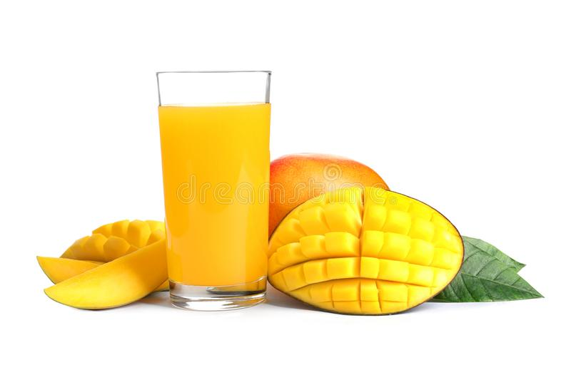 Fresh tropical mango juice and fruits, isolated. On white royalty free stock images