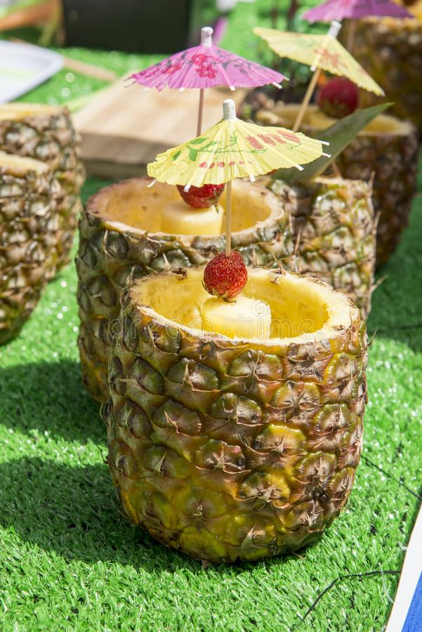 Fresh Tropical Pina Colada cocktail served in a pineapple stock images
