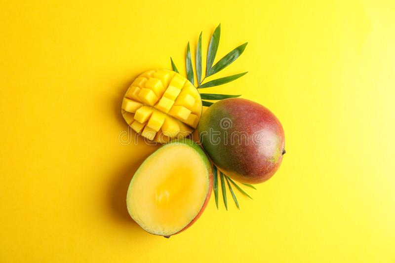 Fresh tropical ripe mango on color background. Top view stock photography