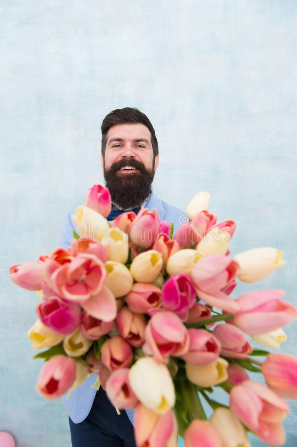 Fresh tulips. spring bouquet. 8 of march. bride groom at wedding party. womens day. Formal mature businessman. love date stock image